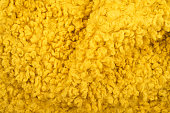 Cozy and bright yellow wool plush texture background.