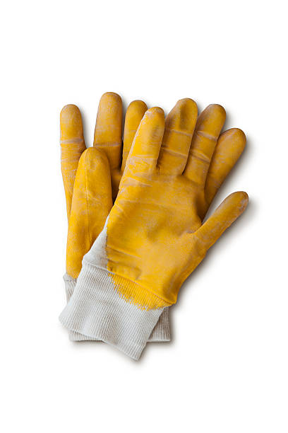 Yellow work gloves with clipping path stock photo