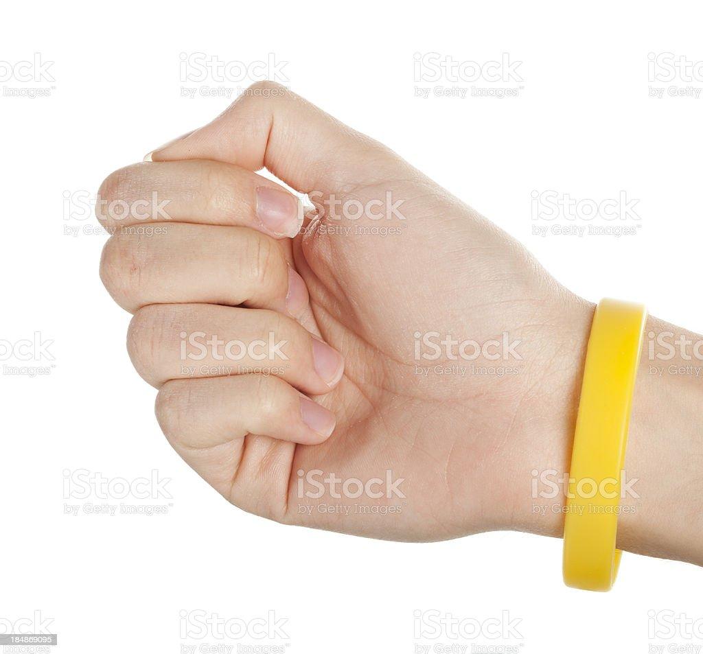 Yellow wristband stock photo