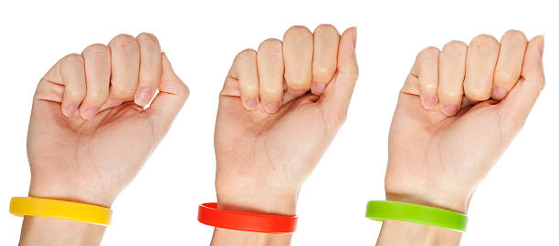 Yellow,green and red  wristbands  wristband stock pictures, royalty-free photos & images