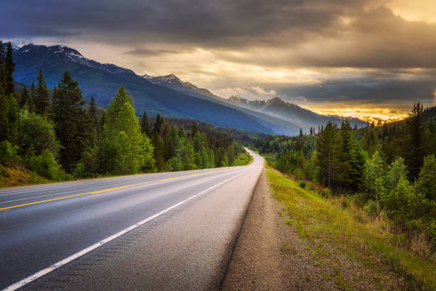 Scenic Icefields Pkwy in Banff National Park at sunset Scenic Icefields Pkwy in Banff National Park at sunset. It travels through Banff and Jasper National Parks and offers spectacular views of the Rocky mountains. rocky mountains north america stock pictures, royalty-free photos & images