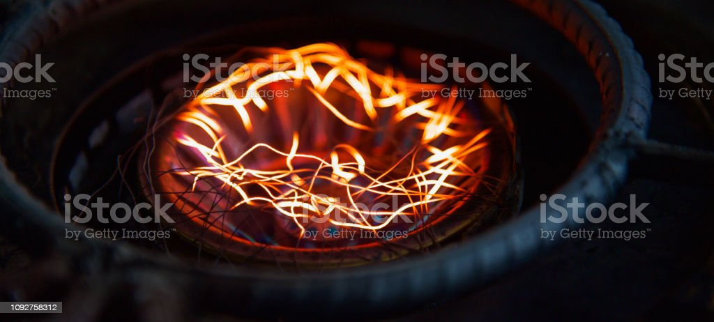 Yellowish fires of a cooking stove unique photo stock photo