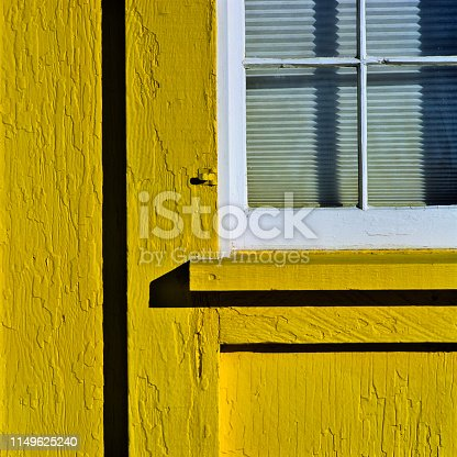 Yellow door in the community of Lake in Yellowstone National Park
