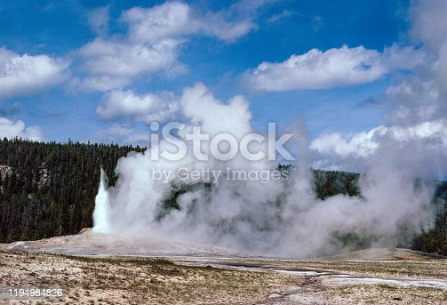 Yellowstone National Park -  Old Faithful Starting to Erupt - 1981. Scanned from Kodachrome slide.