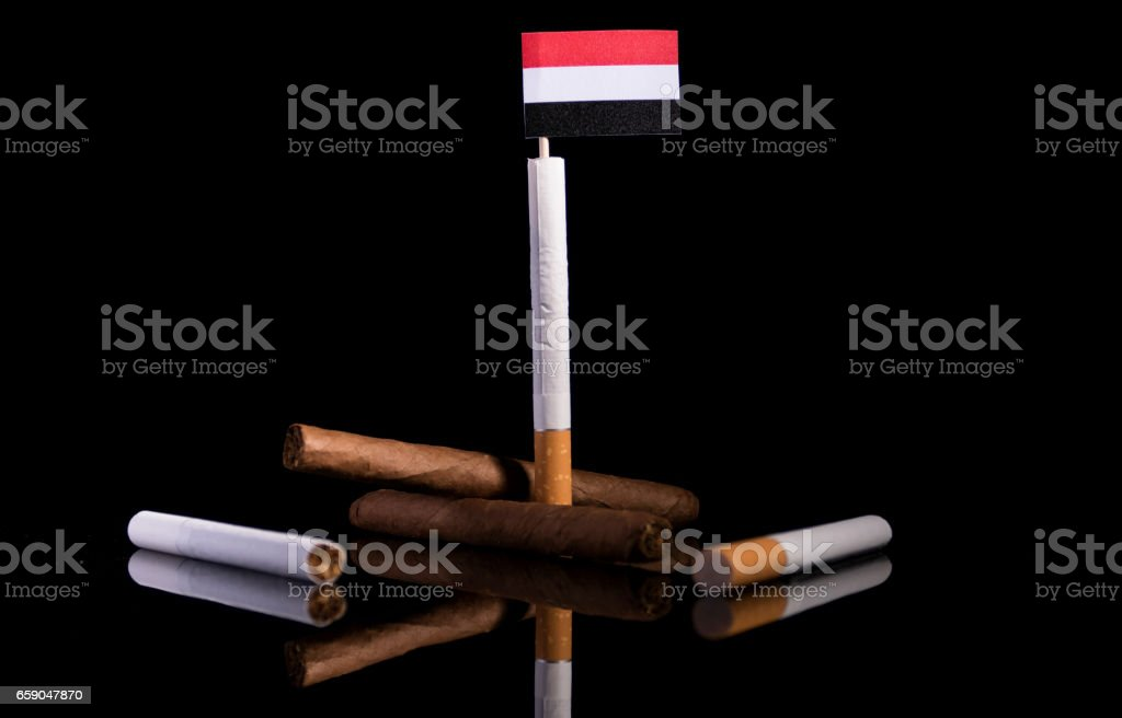 Yemeni flag with cigarettes and cigars. Tobacco Industry concept. royalty-free stock photo