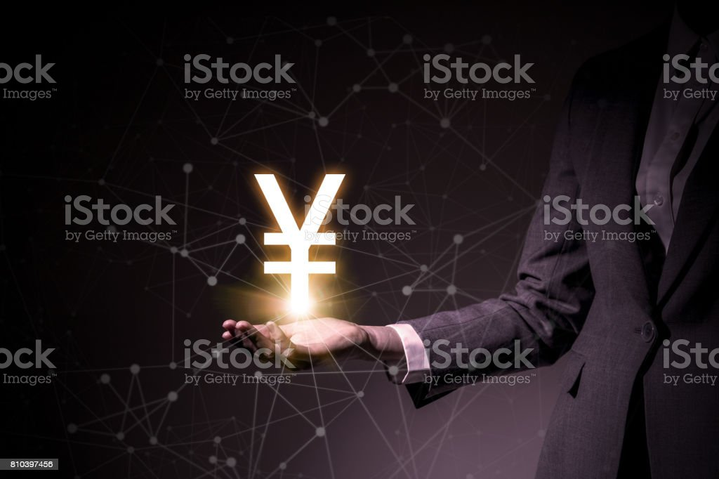 Yen symbol floating on woman's hand stock photo