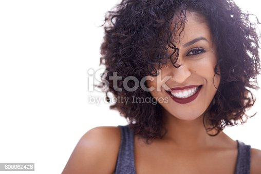 Cropped shot of a beautiful woman with curly hair posing against a white background