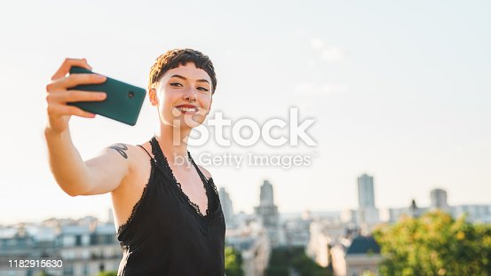 Cropped shot of an attractive young woman taking a selfie while sightseeing in a foreign city during the day