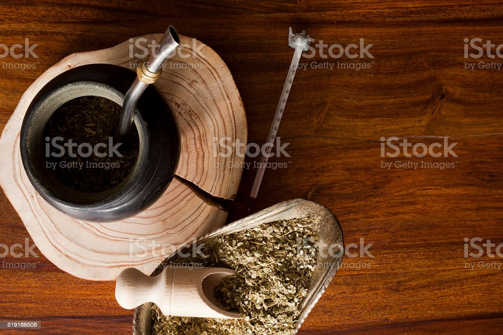 yerba mate gourd on wooden table stock photo