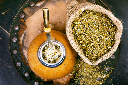 Yerba mate in a traditional gourd and dry herb