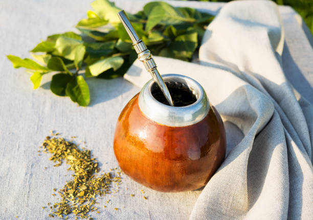 Yerba mate in gourd calabash with bombilla stock photo