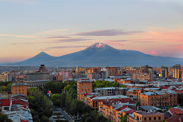Yerevan, Capital of Armenia and the Mount Ararat Yerevan in Armenia and the two peaks of the Mount Ararat at the sunrise. yerevan stock pictures, royalty-free photos & images