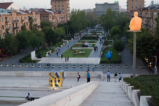 Yerevan Cascade at dusk in Armenia Yerevan, Armenia - October 5, 2016: People enjoy a warm autumn evening at the Cascade, a giant stairway in Yerevan, Armenia. It was designed by architects Jim Torosyan, Aslan Mkhitaryan, Sargis Gurzadyan and completed in 1980 when Armenia was part of the Soviet Union. yerevan stock pictures, royalty-free photos & images