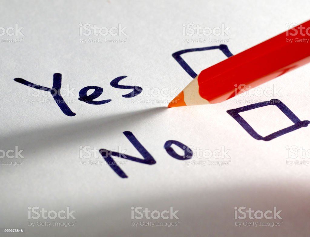 Yes And No Check Boxes On White Paper And Red Pencil Under Side