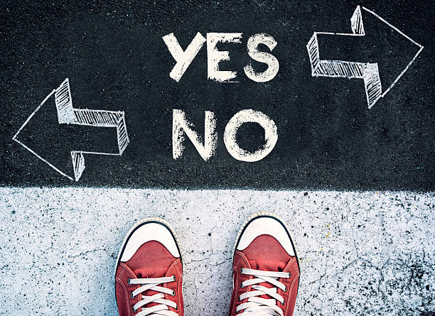Yes and no dilemma Student standing above the yes and no sign,dilemma concept single word no stock pictures, royalty-free photos & images