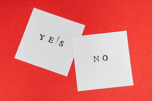 istock yes and no words printed on two sheets 1050665742