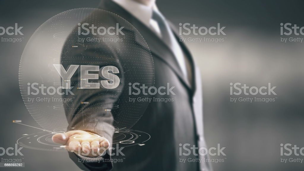Yes Businessman Holding in Hand New technologies stock photo