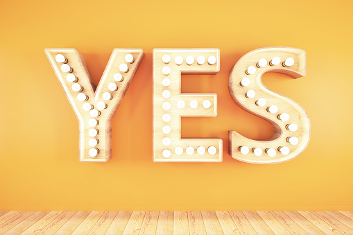 Yes Light Bulb Sign on Orange Background. 3D Render