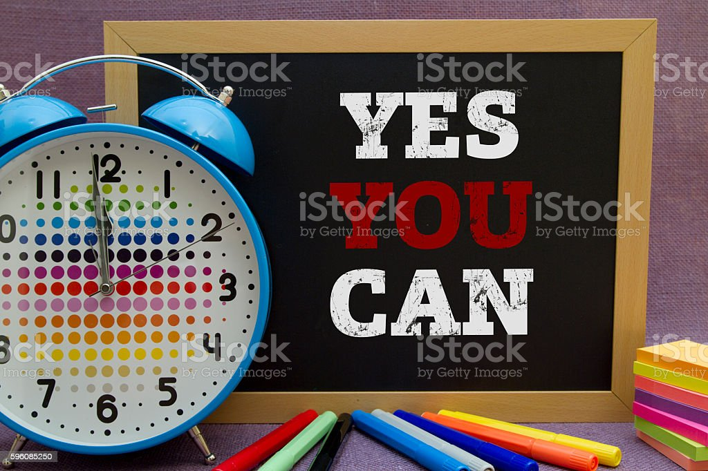 Yes You Can message written on blackboard on burlap background. royalty-free stock photo