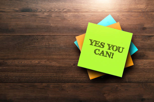 Yes You Can , the phrase is written on multi-colored stickers, on a brown wooden background. Business concept, strategy, plan, planning. Yes You Can!, the phrase is written on multi-colored stickers, on a brown wooden background. Business concept, strategy, plan, planning. encouragement stock pictures, royalty-free photos & images