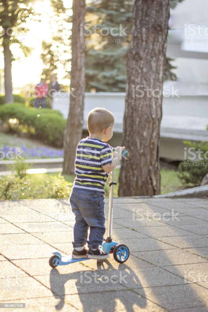 Yesterday Learning To Walk, Today Learning To Ride royalty-free stock photo