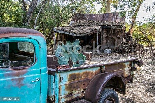 Old rusty pickup truck at an abandoned homestead. Sonoran Desert near Phoenix, Arizona. American Southwest.