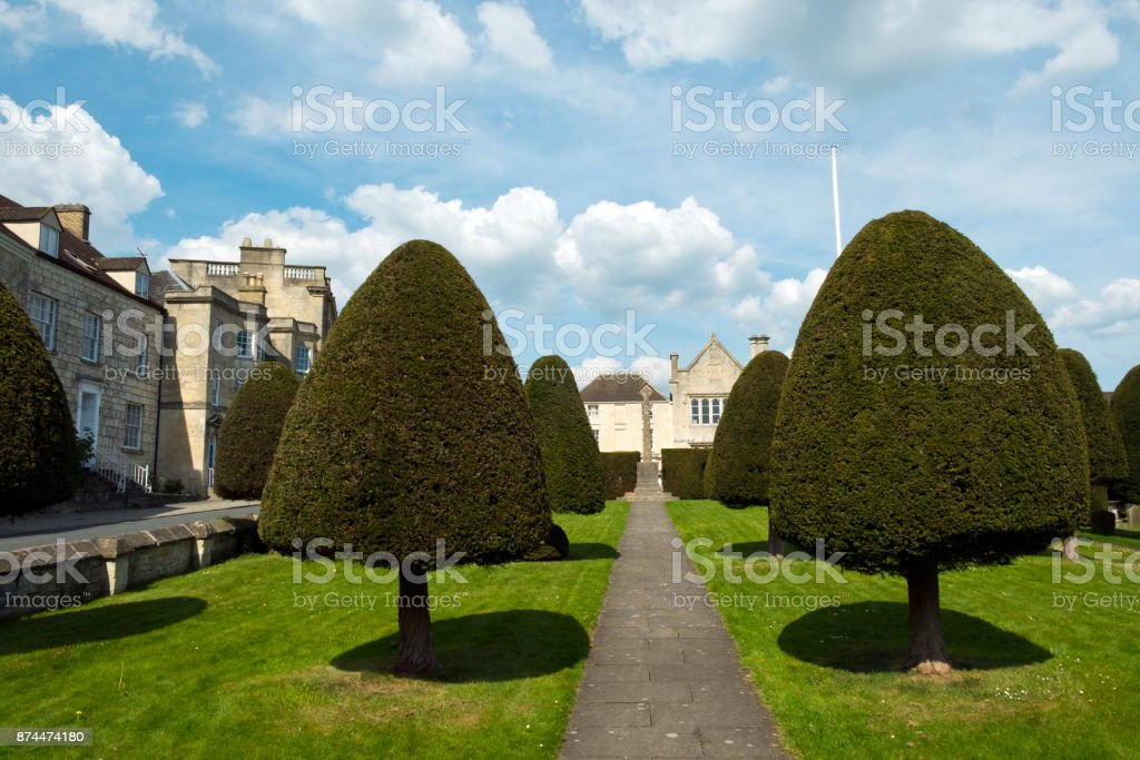 Yew trees in the churchyard at Painswick, Gloucestershire, UK stock photo
