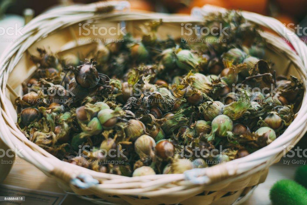 Yield of hazel in wooden wattled basket stock photo