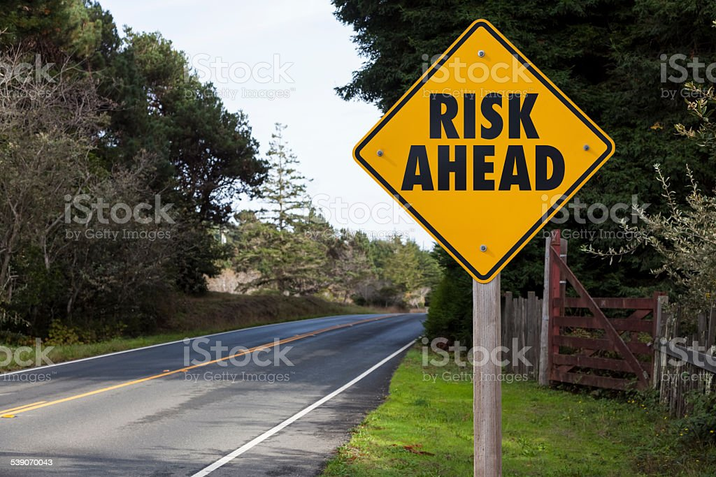 Yield Sign Risk stock photo