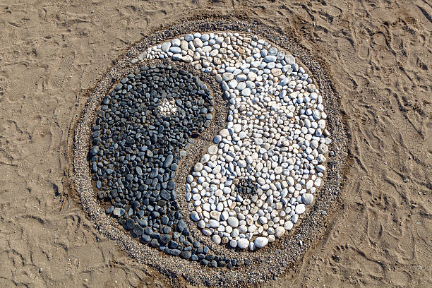 yin and yang of stones - yin yang symbol stock photos and pictures