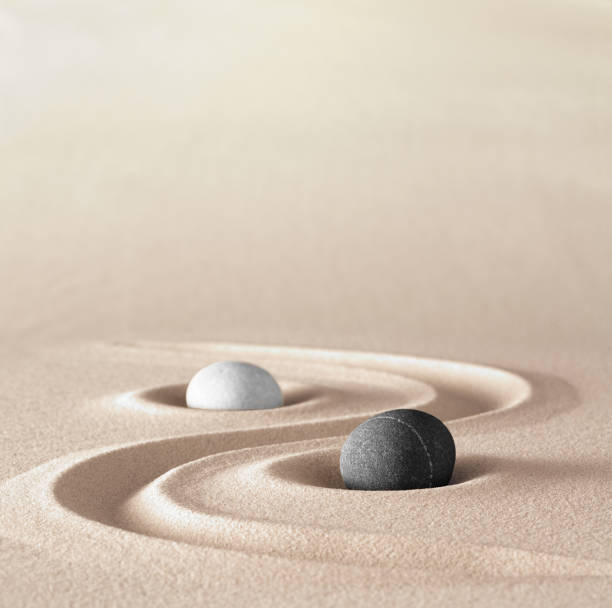 yin and yang symbol of dualism in ancient chinese philosophy where opposite or contrary forces are complementary - yin yang symbol stock pictures, royalty-free photos & images