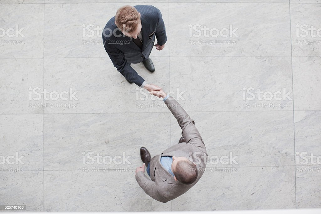 Yin Yang businessman handshake stock photo