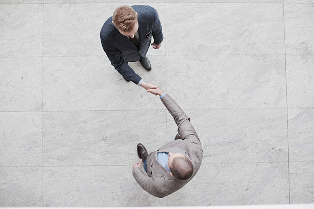 yin yang businessman handshake - yin yang symbol stock pictures, royalty-free photos & images