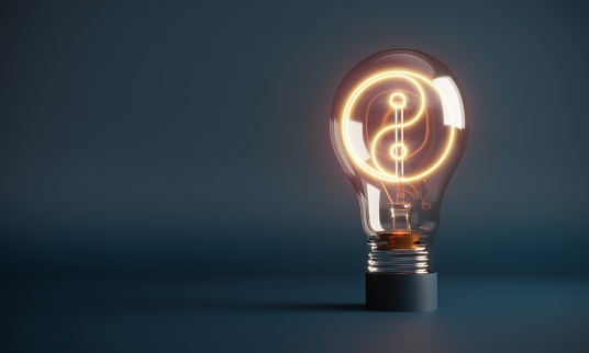 Yin yang symbol in the glowing light bulb. (3d render)