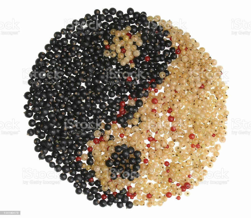 Yin Yang symbol made from different currants royalty-free stock photo