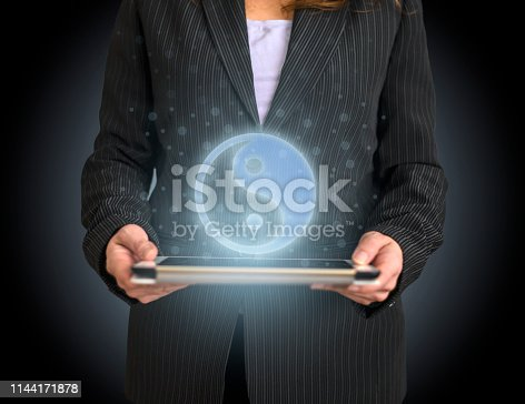 istock Yin yang Symbol on tablet with hologram 1144171878