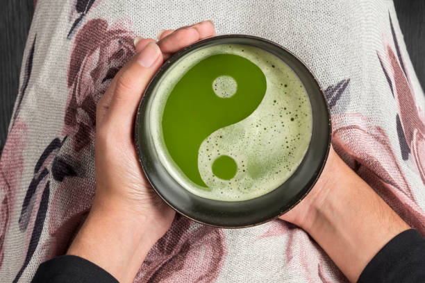 ying yang symbol on japanese matcha tea - yin yang symbol stock pictures, royalty-free photos & images