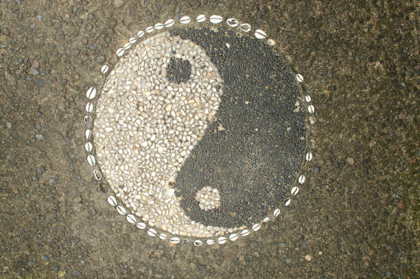 Yin-Yang Symbol made of little stone pebbles Picture of Yin-yang symbol made of little stone pebbles located outside a restaurant in Ubud, Bali taoism stock pictures, royalty-free photos & images