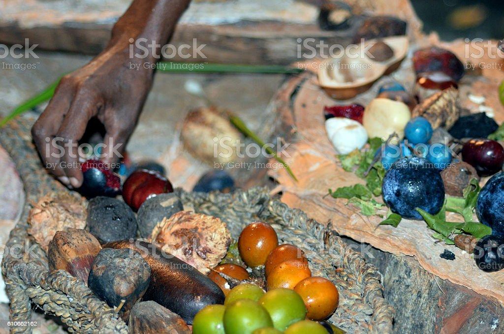 Yirrganydji Aboriginal woman hand assorting fruit and seeds food stock photo