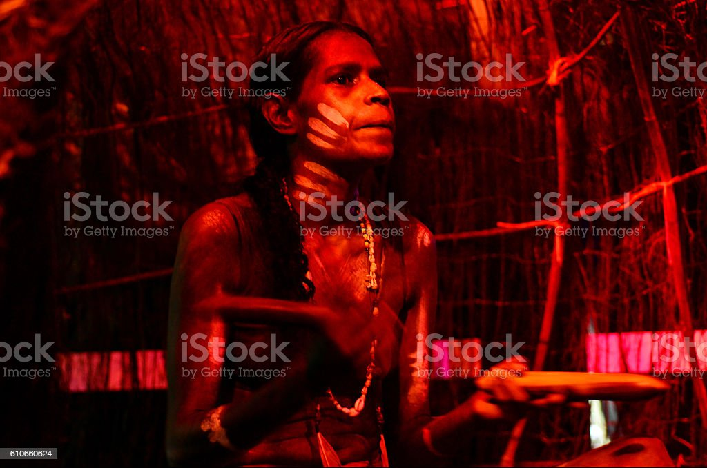 Yirrganydji Aboriginal woman play Aboriginal music with Clapstic stock photo