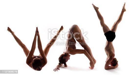 istock Yoga alphabet, athlete forming WAY word over white background 1137958076