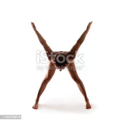 Yoga alphabet. The letter X formed by gymnast body