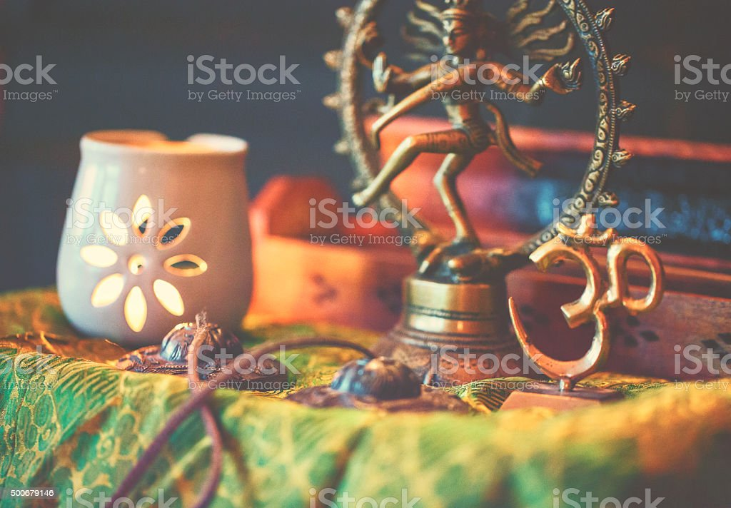 Yoga altar with light and Shiva sculpture stock photo