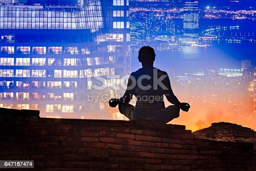 istock Yoga and city background – double exposure 647187474