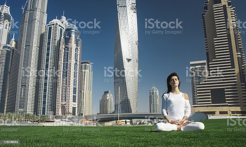 Yoga and meditation in a modern urbanistic city royalty-free stock photo