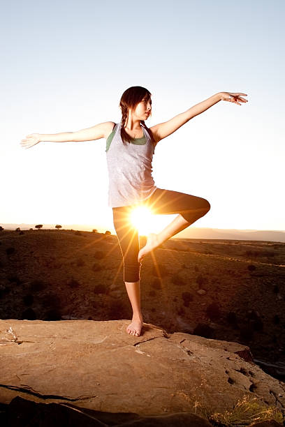 Yoga at dusk Pretty teen dancing at sunset new age music stock pictures, royalty-free photos & images
