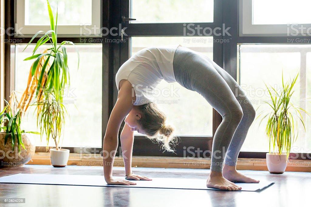 Yoga at home: Bridge Pose stock photo