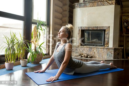 istock Yoga at home: Cobra Pose 613020678