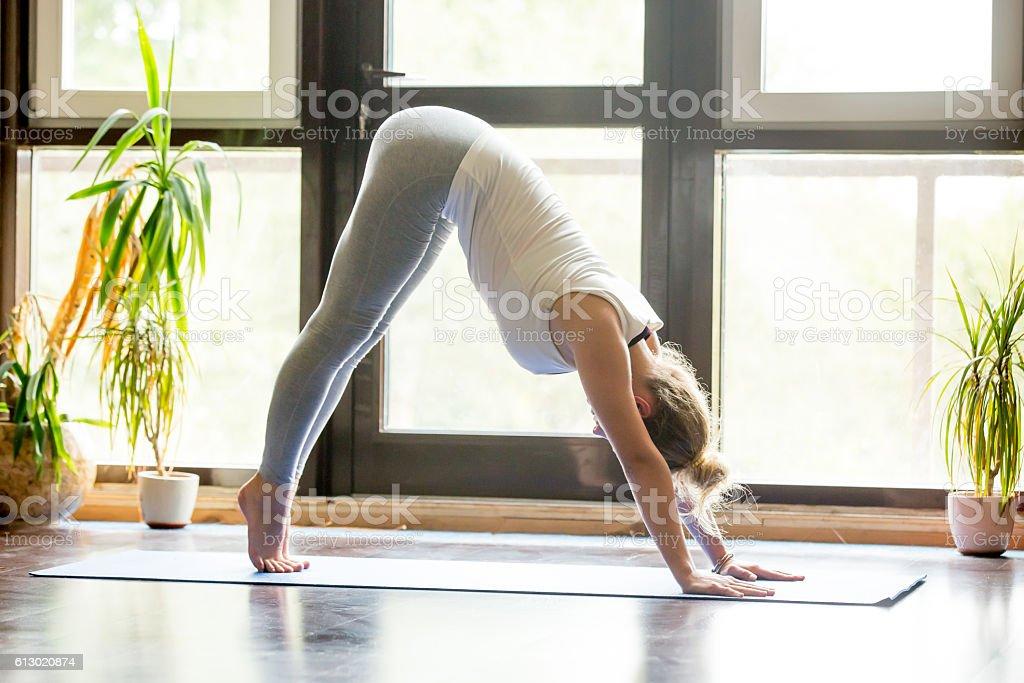 Yoga at home: Downward Facing Dog Pose stock photo