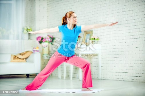 973962328istockphoto Yoga at home 170039658